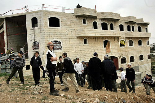 Colonos israelíes en Hebron (Foto:Reuters)