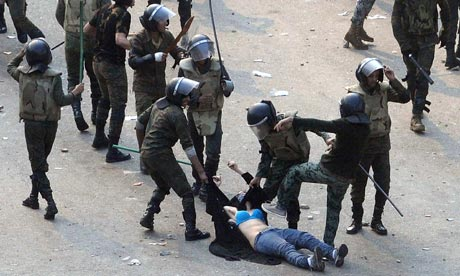 EgyptianArmySoldiersBeatingDraggingYoungWoman.Reuters