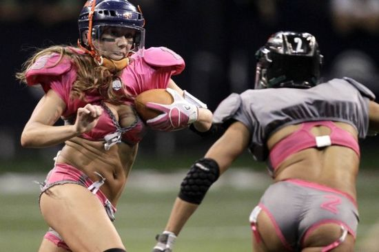 Furr-of-the-Western-Conference-team-runs-with-the-ball-as-Leach-of-the-Eastern-Conference-runs-toward-her-during-a-Lingerie-Football-League-exhibition-match-in-Mexico-City