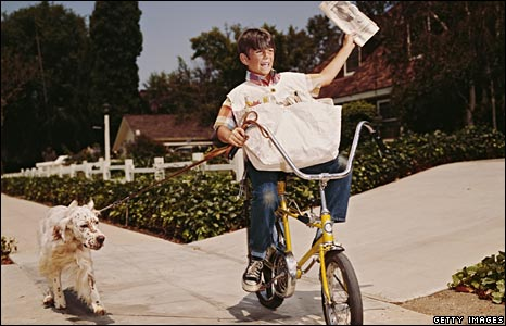 Repartidor de periódicos en bici. Getty