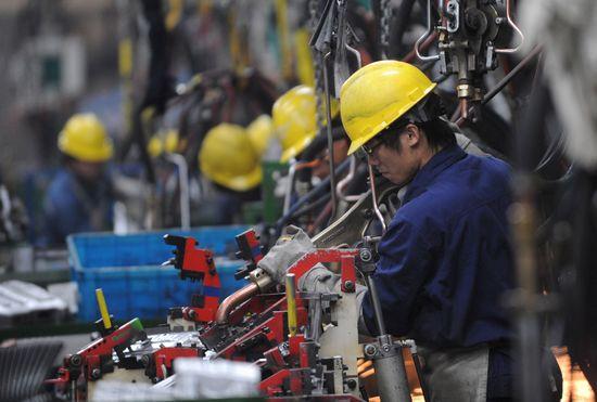 Trabajadores chinos / Foto: Cordon Press