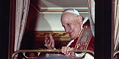 Juan XXIII en tren a Asís