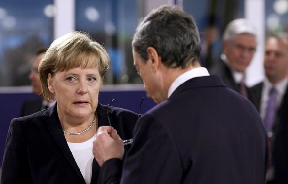 Merkel y Draghi.