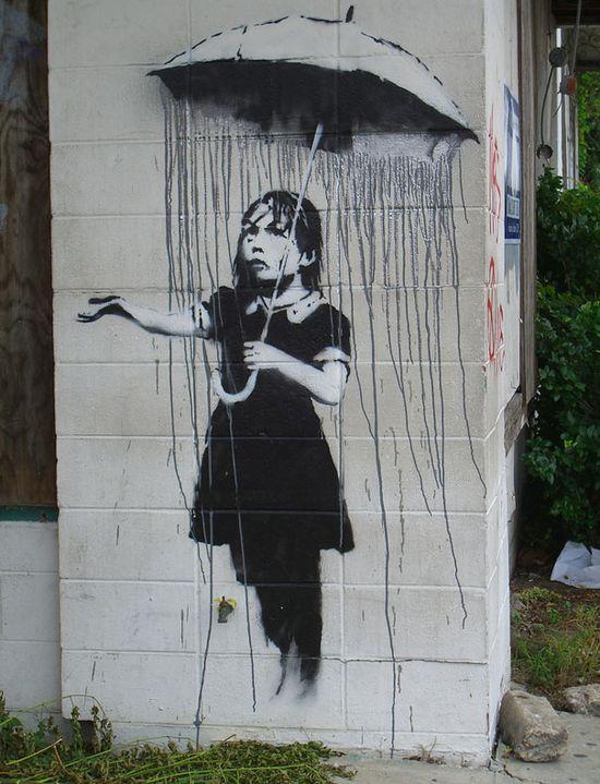 Banksy-graffiti-street-art-girl-with-umbrella