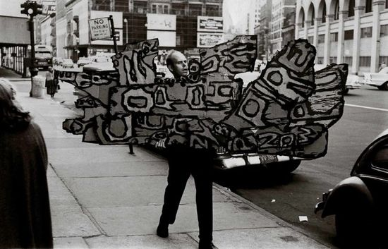 Oldenburg carrying Street Sign I  1960 to the Reuben Gallery in New York