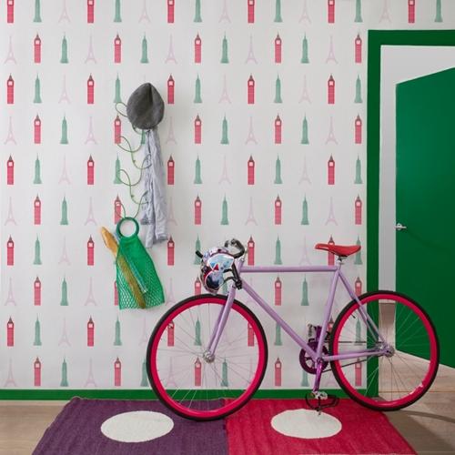 Anuncio de papel pintado de Cordonne con una bicicleta.