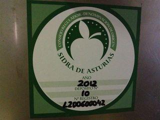Sello de control del Consejo Regulador de la Denominación de Origen Sidra de Asturias