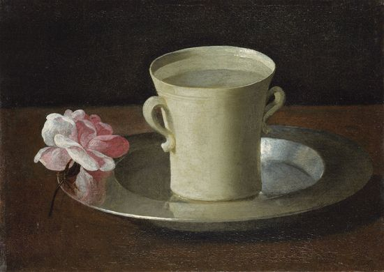 Taza de agua y rosa