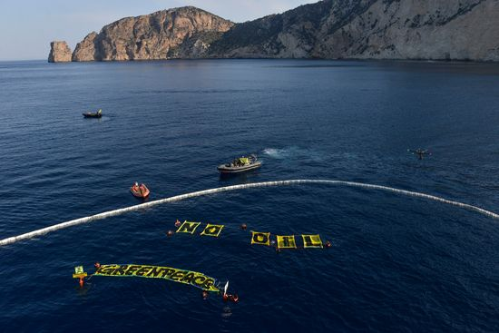 Activists from the Greenpeace ship Rainbow Warrior protest at Es Vedrà Islets Nature Reserve near Ibiza, Spain. PHOTO CREDIT  Pedro Armestre  Greenpeace