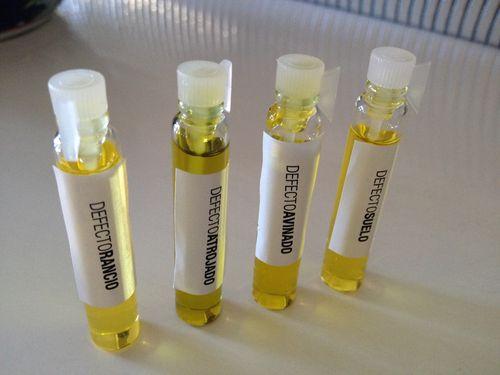 Esencieros o probadores repletos de aceites  de oliva con defectos